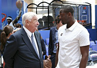 Ambassador Susman talks to NBA star Dwyane Wade at a sports clinic for London area kids.