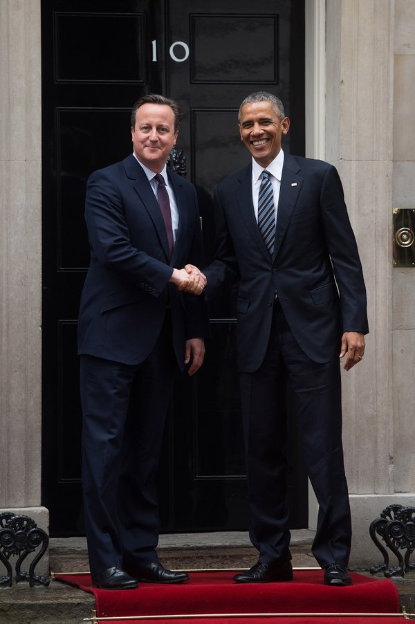 President Obama shakes hands with the UK Prime Minister David Cameron outside Number 10 Downing Street in London, today