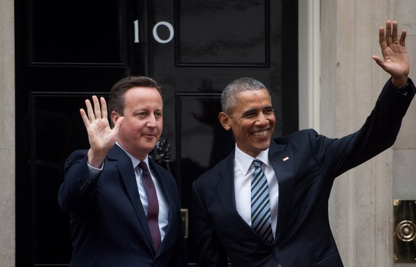 President Obama and UK Prime Minister David Cameron wave to the press as they meet at Number 10 Downing Street