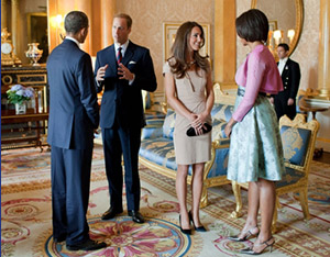 President Barack Obama and First Lady Michelle Obama talk with the Duke and Duchess of Cambridge in the 1844 Room at Buckingham Palace in London, England