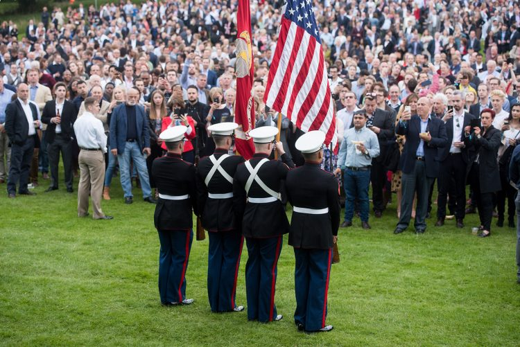 U.S. Marines present 'Old Glory' and the 'Stars and Stripes' at the 4th of July Party at Winfield House, 30 June 2015